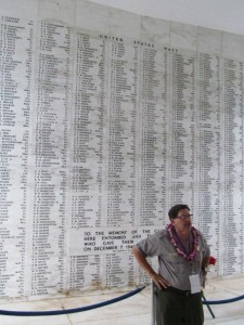 Battleship USS ARIZONA Memorial, Pearl Harbor. Chief National Park Service historian Daniel Martinez at Shrine Room wall with the inscribed name of Wilmingtonian Signalman Harvey  Howard Horrell, killed on Dec. 7, 1941. Visited on 70th anniversary, 2011.