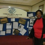 Glancy Thomas, chair of the City of Wilmington Commission on African-American History, with board displaying history of the wartime 9th & Nixon Streets black USO. 70th anniversary of the HBHUSO/CAC.