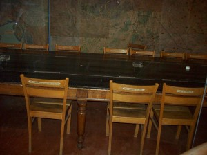 Actual table, chairs and setting of German surrender signing, May 7, 1945, in Gen/ Eisenhower's SHAEF HQ in Reims, France. Gen. Jodl, German representative, sat in middle chair. 2008/10.