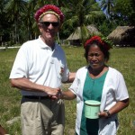 Presenting gift of tobacco to principal of elementary school at Ukiangang village, Butaritari island, Makin Atoll, Kiribati - 66th anniversary of liberation by U.S. Army. 2009