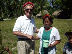 Presenting gift of tobacco to principal of elementary school at Ukiangang village, Butaritari island, Makin Atoll, Kiribati - 66th anniversary of liberation by U.S. Army. 2009