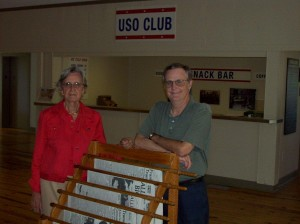 Coalition vice chairman Doris Ayers with Community Arts Center Accord USO historian Everard Smith and restored wartime newspaper rack. 2008.