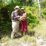 Exchanging gifts with villager on Buariki, northernmost island in Tarawa Atoll where final battle was fought by 6th Marines. Mine was chewing tobacco, his pandanus roots. 2008.