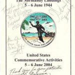 Program of airborne drop at Ste. Mere Eglise, Normandy, June 2004. Autographed by Speaker of the House Hastert, Joint Chiefs of Staff Chairman Gen. Meyer, USArmy Europe commander Gen. Bell, and SME mayor LeFevre.