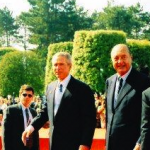 President Bush with French President Chirac at 60th anniversary commemoration service, Normandy American Cemetery, Colleville-sur-Mer. June 6, 2004.