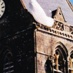 "Dummy of 82nd Airborne paratrooper John Steele (Red Buttons in ""The Longest Day"") hung up on church steeple in main place of Ste. Mere Eglise, Normandy. Steele later lived in Wilmington for 13 years. 2004/10."