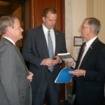 U.S. Rep. Mike McIntyre (7th District-N. C.), left, and Captain Wilbur Jones (right) visit with Rep. Jon Runyan. 2012