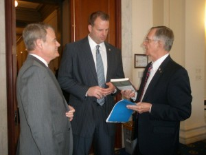 U.S. Rep. Mike McIntyre (7th District-N. C.), left, and Captain Wilbur Jones (right) visit with Rep. Jon Runyan. 2012