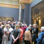 "Crowds gather to view Rembrandt's ""Night Watch,"" perhaps the world's second most famous painting. Rijksmuseum, Amsterdam, Netherlands. 2014."