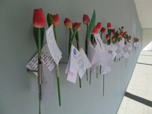 Tulips and memory notes at the Hollandsche Schouwburg Deportation Museum, Amsterdam, Netherlands, in the building where thousands of Jews were deported 1940-45. 2014..