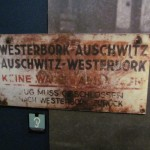 Railroad sign which deceived Jewish deportees into thinking they were on a round trip to the Nazi extermination camp Auschwitz, Poland, and back home. Dutch Resistance Museum in Amsterdam. 2014.